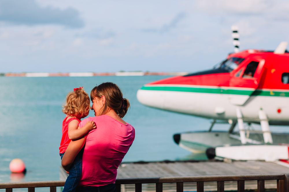 little-daughter-waiting-seaplane